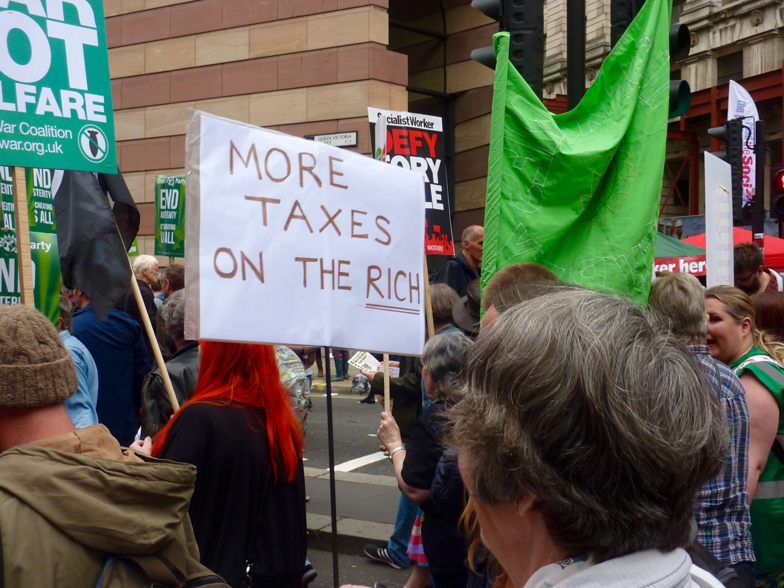 banner calling for more taxes on the rich