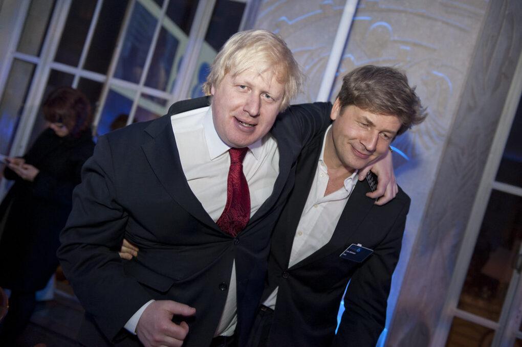 Boris Johnson leaning on Leo Johnson, both obviously drunk